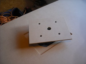 Base plate attached to the router, with router ready to drop in place