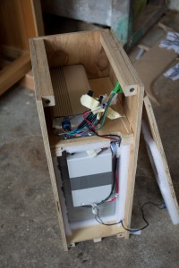 Battery box open showing controller above battery