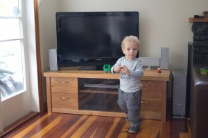 Son modelling the new TV cabinet